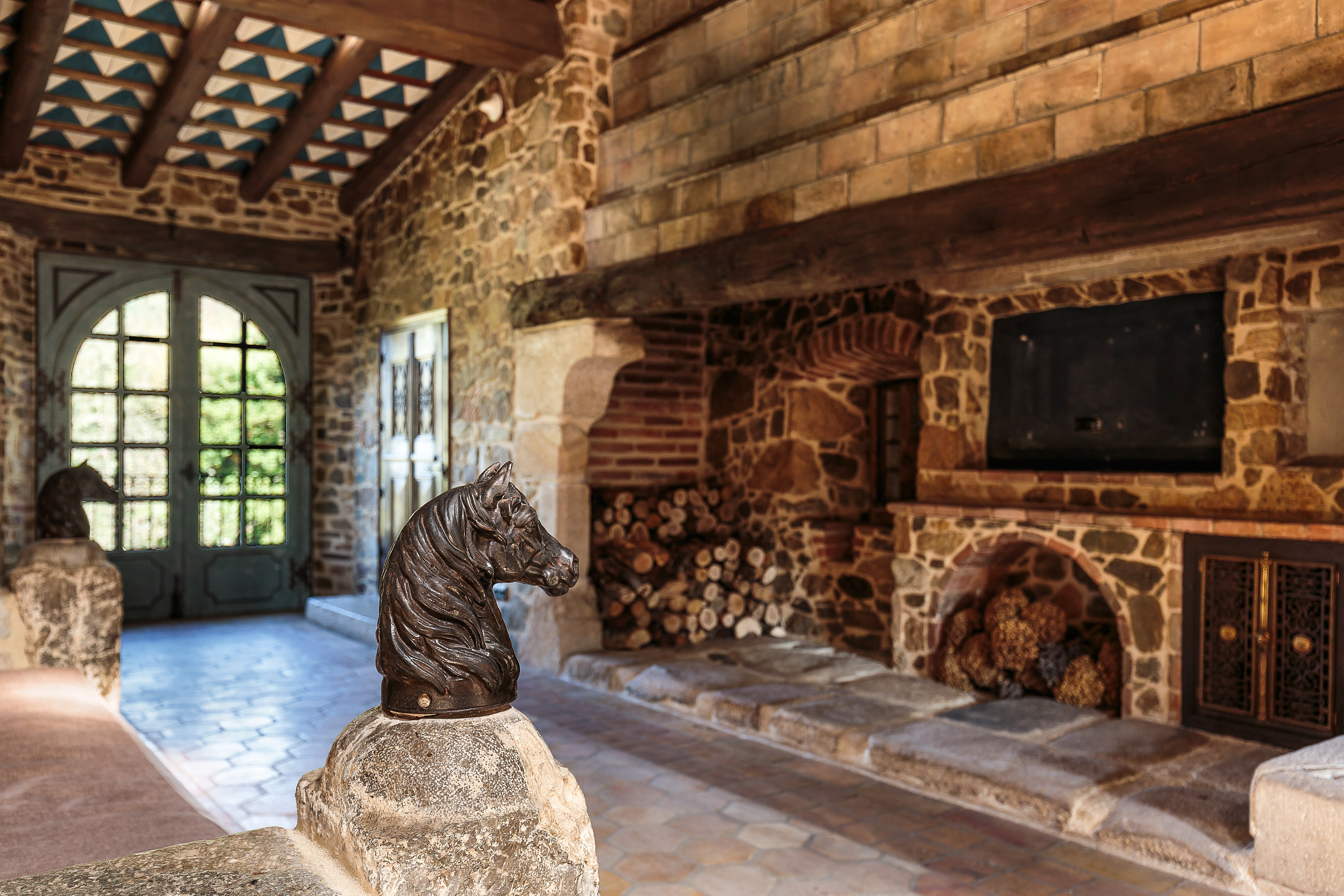 Exposed stone walls and wooden beams