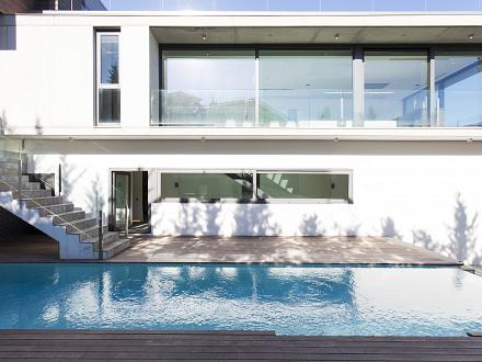 Contemporary facade and pool area